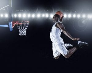 Player airborne to make the dunk
