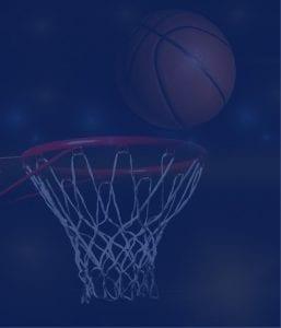 Closeup of basketball hoop and ball