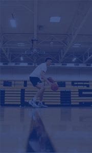 Dribbling a basketball in a high school practice